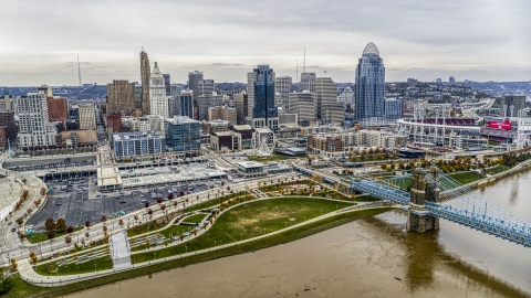 DXP001_000483 - Aerial stock photo of The city's skyline behind a riverfront park by the Ohio River in Downtown Cincinnati, Ohio