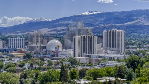 DXP001_004_0004 - Aerial stock photo of Hotels and casinos with mountains in the background in Reno, Nevada