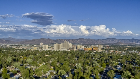 DXP001_005_0004 - Aerial stock photo of The city skyline seen from tree-lined neighborhoods in Reno, Nevada
