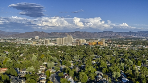 DXP001_005_0005 - Aerial stock photo of City skyline seen from tree-lined neighborhoods in Reno, Nevada