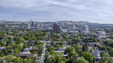 DXP001_006_0014 - Aerial stock photo of A wide view of high-rise casino resorts and office buildings seen from a neighborhood in Reno, Nevada