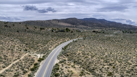 DXP001_007_0004 - Aerial stock photo of A desert road in Carson City, Nevada