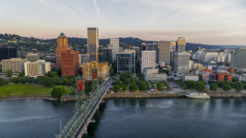 DXP001_010_0003 - Aerial stock photo of City skyline and Hawthorne Bridge spanning the Willamette River, Downtown Portland, Oregon