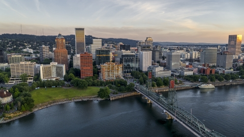 DXP001_010_0004 - Aerial stock photo of City skyline and Hawthorne Bridge over the Willamette River, Downtown Portland, Oregon