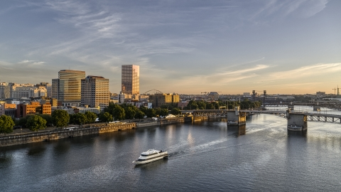DXP001_010_0009 - Aerial stock photo of Office buildings, skyscrapers, and the Morrison Bridge seen from the Willamette River, Downtown Portland, Oregon