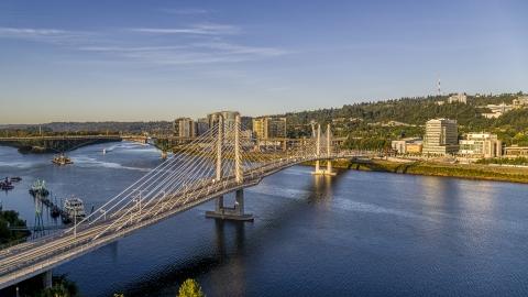 DXP001_010_0013 - Aerial stock photo of Tilikum Crossing Bridge spanning the Willamette River, South Portland, Oregon