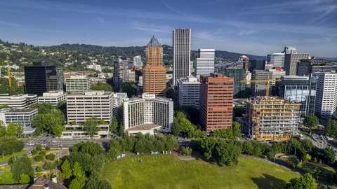 DXP001_011_0013 - Aerial stock photo of Marriott hotel flanked by taller office buildings and towering skyscrapers in Downtown Portland, Oregon