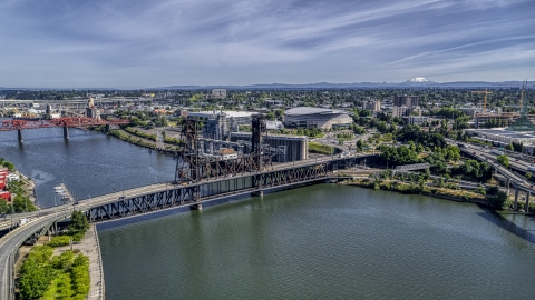 DXP001_012_0006 - Aerial stock photo of The Steel Bridge spanning the Willamette River near Moda Center arena, Northeast Portland, Oregon