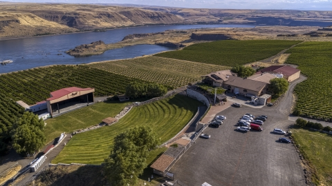 DXP001_018_0019 - Aerial stock photo of The Maryhill Winery, amphitheater, and vineyards beside the Columbia River in Goldendale, Washington