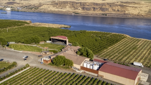 DXP001_019_0006 - Aerial stock photo of The Maryhill Winery amphitheater stage, main building, Columbia River in Goldendale, Washington