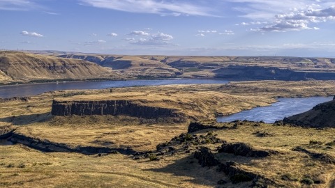 DXP001_019_0009 - Aerial stock photo of Miller Island and the Columbia River seen from a cliff in Goldendale, Washington