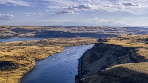 DXP001_019_0010 - Aerial stock photo of A view of Miller Island and the Columbia River seen from the edge of a cliff in Goldendale, Washington