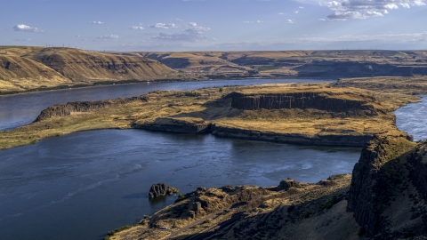 DXP001_019_0015 - Aerial stock photo of Miller Island and the Columbia River viewed from cliffs in Goldendale, Washington