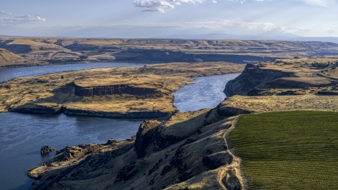 DXP001_019_0023 - Aerial stock photo of Miller Island and the Columbia River seen from cliff by Maryhill Winery in Goldendale, Washington