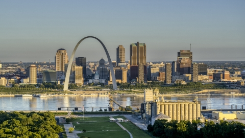 DXP001_021_0001 - Aerial stock photo of The Arch and city skyline across the Mississippi River at sunrise, Downtown St. Louis, Missouri