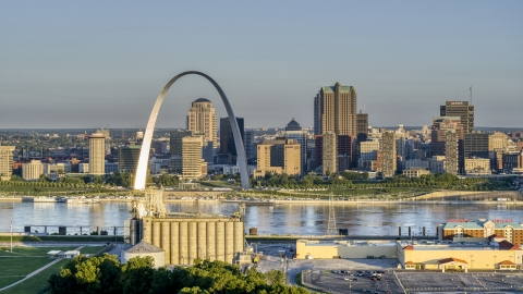 DXP001_021_0002 - Aerial stock photo of The Arch and skyline, seen from a casino by the Mississippi River, sunrise, Downtown St. Louis, Missouri