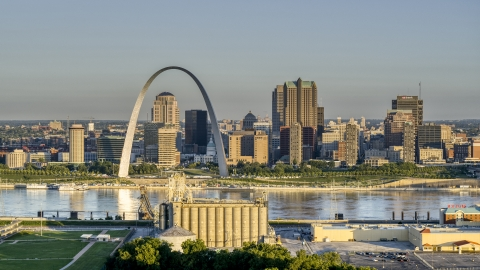 DXP001_021_0003 - Aerial stock photo of A grain elevator and casino against The Arch and skyline at sunrise, Downtown St. Louis, Missouri
