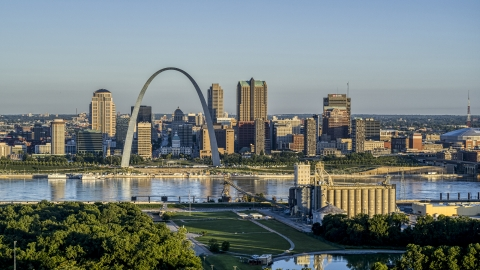 DXP001_021_0006 - Aerial stock photo of A grain elevator and park with a view of the Arch and skyline across the Mississippi River, sunrise, Downtown St. Louis, Missouri