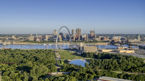 DXP001_022_0001 - Aerial stock photo of A park and the St. Louis skyline across Mississippi River,Downtown St. Louis, Missouri