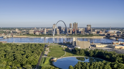 DXP001_022_0005 - Aerial stock photo of Riverfront park with Arch and skyline across the river, Downtown St. Louis, Missouri