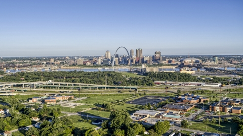 DXP001_022_0006 - Aerial stock photo of School and interstate in East St. Lous with view of skyline and Arch in Downtown St. Louis, Missouri