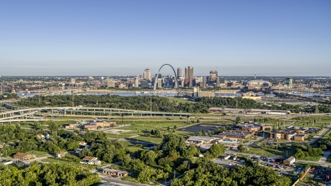 DXP001_022_0007 - Aerial stock photo of A wide view of skyline and Arch from interstate and park, Downtown St. Louis, Missouri