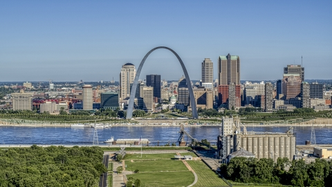 DXP001_023_0001 - Aerial stock photo of The Mississippi River and Gateway Arch by the skyline, Downtown St. Louis, Missouri