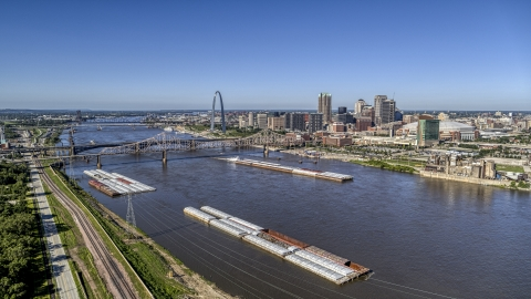 DXP001_023_0002 - Aerial stock photo of Barges in the river near the Gateway Arch in Downtown St. Louis, Missouri