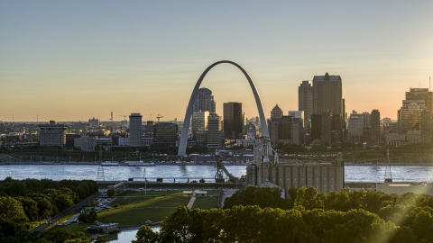 DXP001_028_0003 - Aerial stock photo of The famous Gateway Arch at sunset in Downtown St. Louis, Missouri