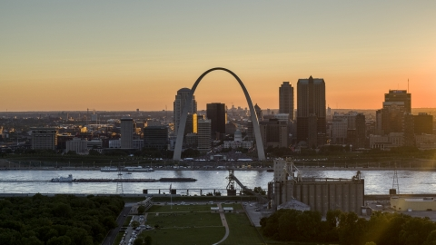 DXP001_029_0001 - Aerial stock photo of A view of the iconic Gateway Arch and Downtown St. Louis, Missouri at sunset