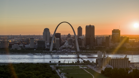 DXP001_029_0002 - Aerial stock photo of The iconic Gateway Arch and Downtown St. Louis skyline, Missouri at sunset