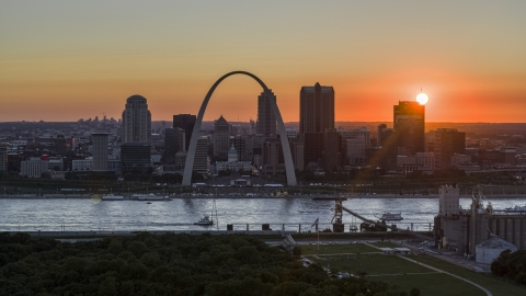 DXP001_029_0006 - Aerial stock photo of Gateway Arch and Downtown St. Louis, Missouri skyline with the setting sun in the background