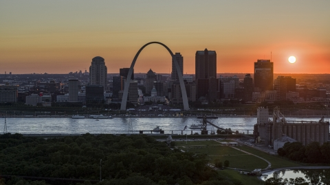 DXP001_029_0007 - Aerial stock photo of The historic Gateway Arch and Downtown St. Louis skyline, Missouri at sunset
