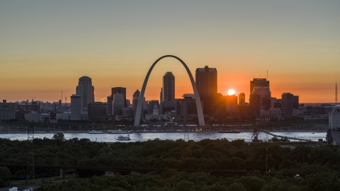DXP001_029_0008 - Aerial stock photo of the Gateway Arch and the Downtown St. Louis, Missouri skyline in silhouette at sunset