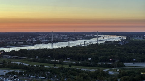 DXP001_029_0009 - Aerial stock photo of The Stan Musial Veterans Memorial Bridge and Mississippi River at sunset in St. Louis, Missouri