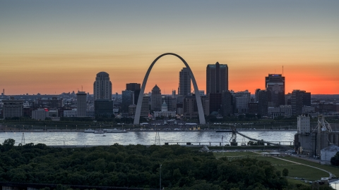 DXP001_029_0012 - Aerial stock photo of Gateway Arch and Downtown St. Louis, Missouri skyline in silhouette at sunset