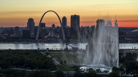 DXP001_030_0001 - Aerial stock photo of The Gateway Geyser and Arch, Downtown St. Louis, Missouri, twilight