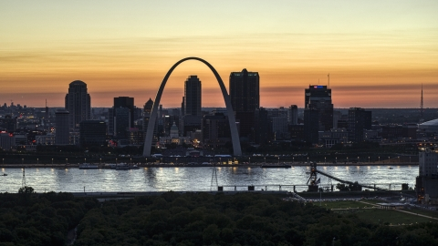 DXP001_030_0005 - Aerial stock photo of The Downtown St. Louis, Missouri skyline across the Mississippi River at twilight