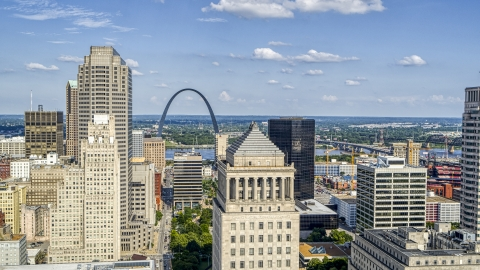DXP001_031_0007 - Aerial stock photo of The Gateway Arch seen between skyscrapers and a courthouse tower in Downtown St. Louis, Missouri