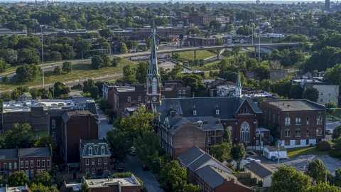 DXP001_033_0007 - Aerial stock photo of A church with a tall steeple in St. Louis, Missouri