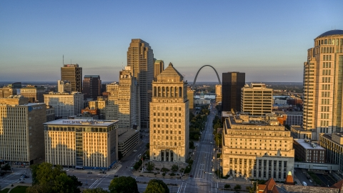 DXP001_035_0004 - Aerial stock photo of The famous Arch seen from the courthouses at sunset, Downtown St. Louis, Missouri
