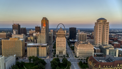 DXP001_036_0004 - Aerial stock photo of The Arch behind the courthouses and skyscrapers at twilight, Downtown St. Louis, Missouri
