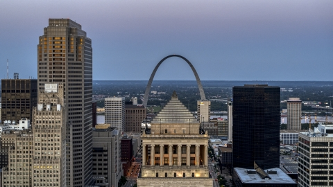 DXP001_036_0014 - Aerial stock photo of Gateway Arch at twilight, visible from a courthouse in Downtown St. Louis, Missouri