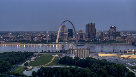 DXP001_037_0002 - Aerial stock photo of The famous Gateway Arch at twilight, visible from across the Mississippi River, Downtown St. Louis, Missouri