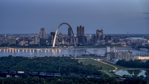 DXP001_037_0003 - Aerial stock photo of The Gateway Arch and the Mississippi River at twilight, Downtown St. Louis, Missouri