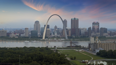 DXP001_037_0008 - Aerial stock photo of The Arch and skyline in Downtown St. Louis, Missouri, by Mississippi River at twilight