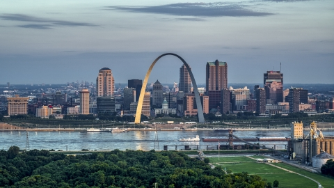 DXP001_038_0004 - Aerial stock photo of A view of the Gateway Arch by the Mississippi River at sunrise in Downtown St. Louis, Missouri