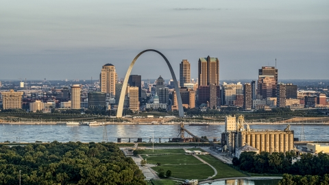 DXP001_038_0007 - Aerial stock photo of A view of the St. Louis Arch and the city skyline at sunrise in Downtown St. Louis, Missouri