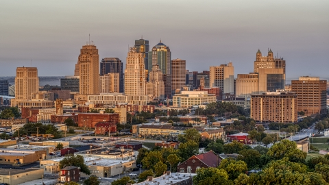 DXP001_040_0002 - Aerial stock photo of The city skyline seen from trees at sunrise, Downtown Kansas City, Missouri