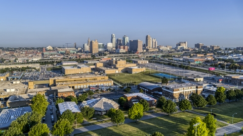 DXP001_041_0002 - Aerial stock photo of The downtown skyline in the distance at sunrise, Downtown Kansas City, Missouri